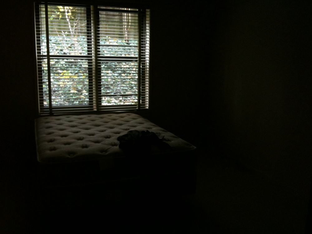 Mattress in empty bedroom